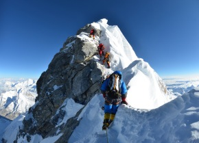 Martin, in blue, crossing over from the south summit to the Hillary Step