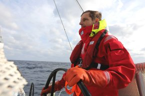 Martin at the helm of Visit Seattle, a 70-foot racing yacht, during his North Pacific sail