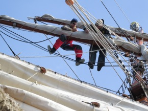 Working the rigging on a square-rigger
